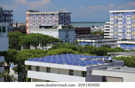 Solar batteries on a building's roof - stock photo