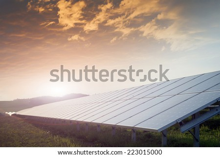 solar battery field against sunset - stock photo