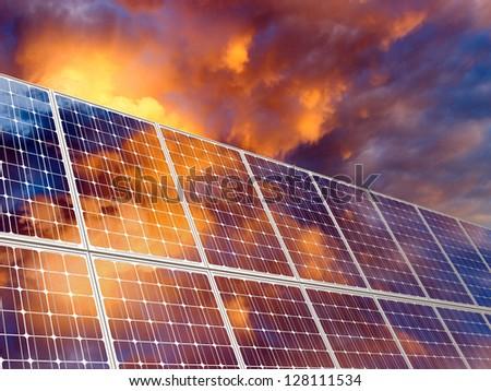 Solar battery on sunset sky background. - stock photo
