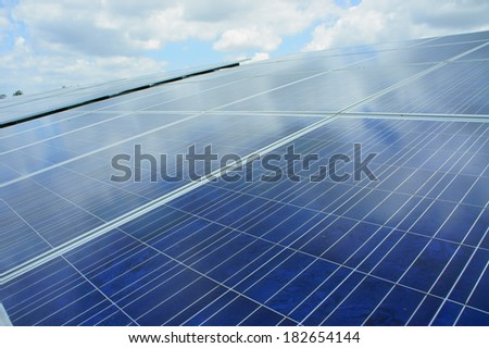 Solar cell and sky reflection - stock photo