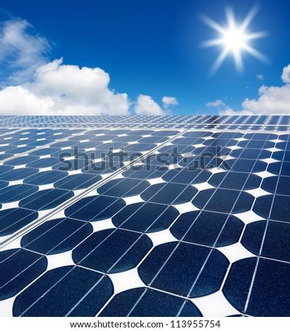 solar cell array against the sun - stock photo