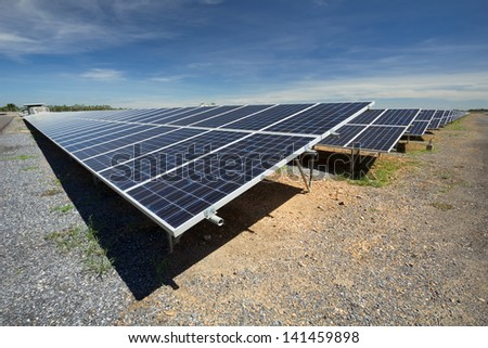 solar cell installed on platform with blue sky - stock photo