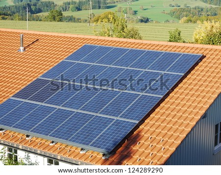 solar cell on on roof producing electricity - stock photo