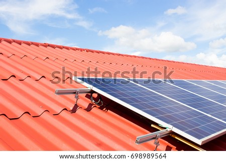 solar cell or photovoltaic on roof top, solar power panel for innovation green energy, electric source	alternative energy system and saving energy	renewable energy for saving world, selective focus.