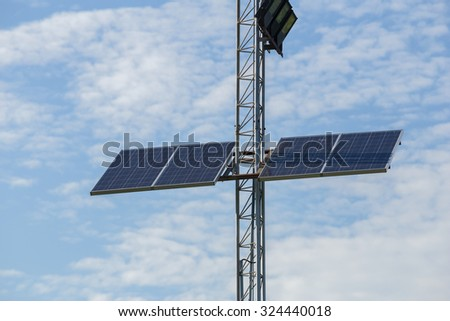 solar cell panel on lamppost with sky background