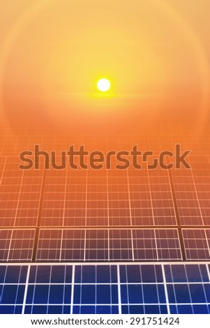 Solar cell panel with sun and sunrise - stock photo