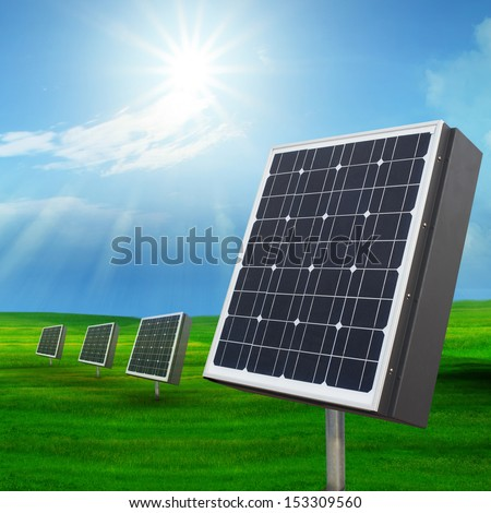 solar cell panels  and  sun shining on blue sky use  for multipurpose - stock photo