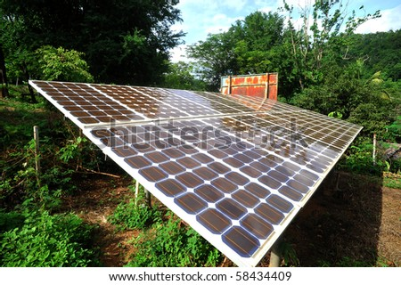 Solar cell panels in urban village, thailand - stock photo