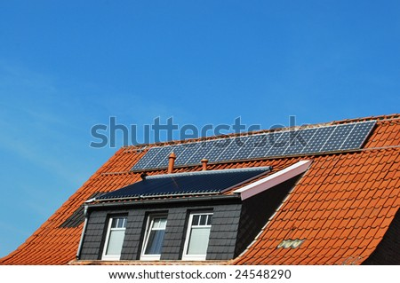 Solar cells on a old roof - stock photo