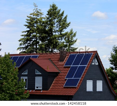 Solar cells on a roof - stock photo