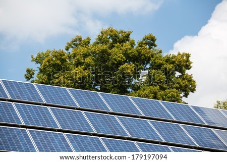 solar cells to generate electricity from solar energy. symbolic photo for alternative energy and environmental protection - stock photo