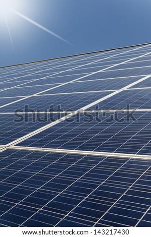 Solar cells with sun beams - stock photo
