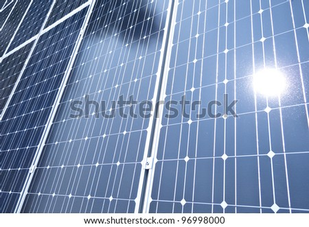 Solar cells with sun reflecting - stock photo