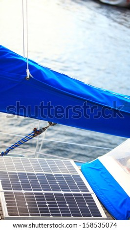 Solar charging batteries aboard a sail boat. Photovoltaic panels renewable eco energy concept