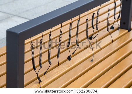 Solar charging bench, solar powered connect table charges devices at outdoor. Made with selective focus. - stock photo