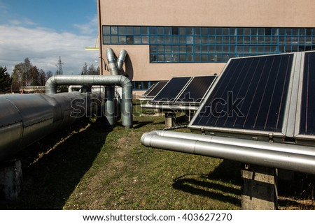 solar collectors supporting the work of heating - stock photo
