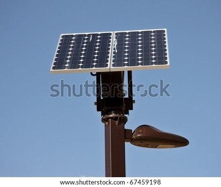 Solar device connected and feeding street lamp - stock photo