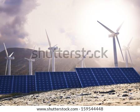 Solar Eco power and wind generators. Renewable clean energy concept. - stock photo
