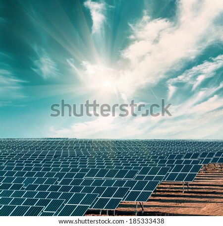 Solar electricity plant under blue sky - stock photo