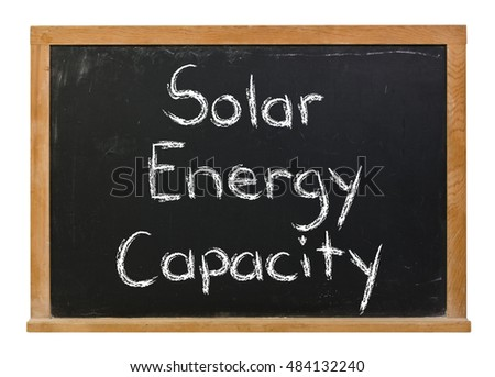 Solar Energy Capacity written in white chalk on a black chalkboard isolated on white