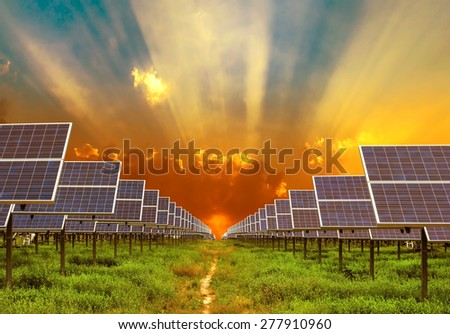 solar energy panel on sunrise background  - stock photo