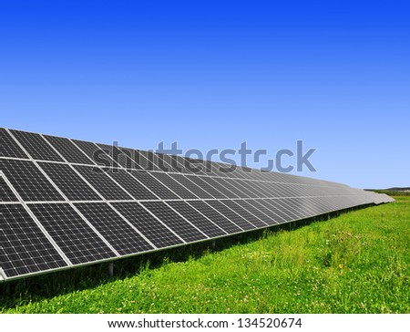 Solar energy panels against blue sky - stock photo