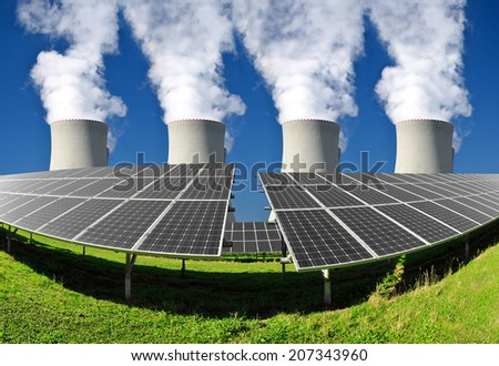 Solar energy panels and nuclear power plant - stock photo