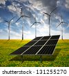 solar energy panels and wind turbine in sunset - stock photo