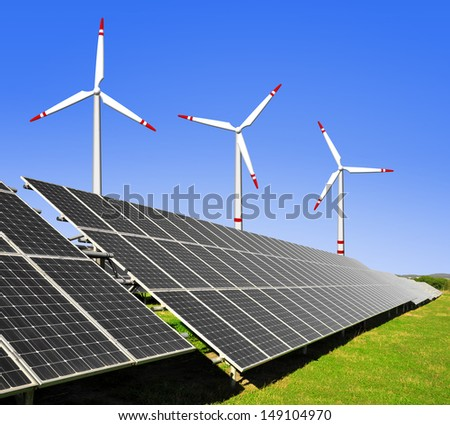 solar energy panels and wind turbines - stock photo
