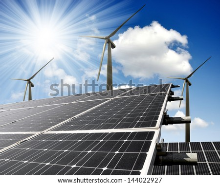 solar energy panels and wind turbines with sunny sky