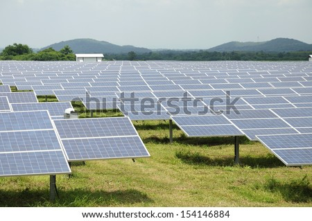 Solar energy panels on a big field  - stock photo