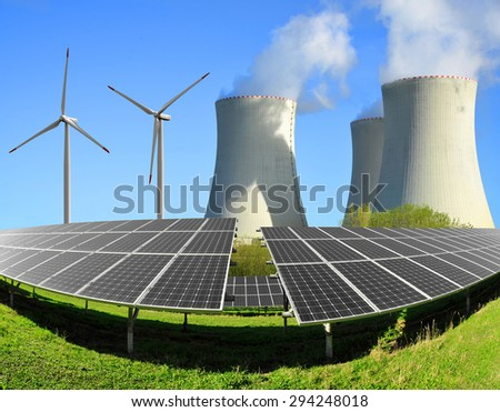 Solar energy panels, wind turbines and nuclear power plant - stock photo