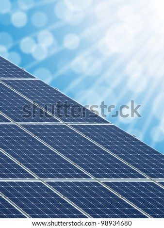 Solar energy panels with blurred background. - stock photo