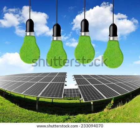 Solar energy panels with bulbs. Green energy concept. - stock photo