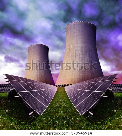 Solar energy panels with nuclear power plant against storm clouds - stock photo