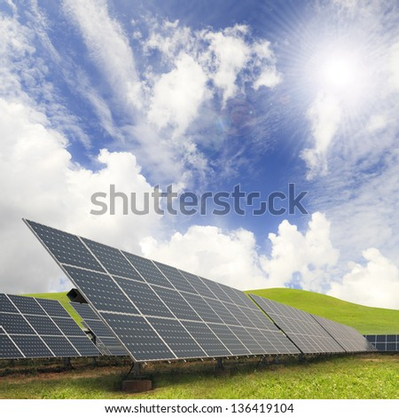 Solar energy plants and blue sky - stock photo