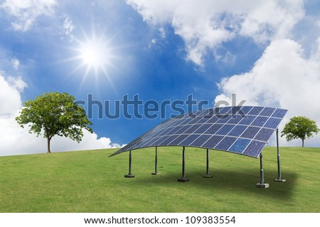 Solar panel and sun in the sky