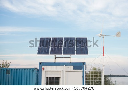 solar panel and wind turbine  - stock photo