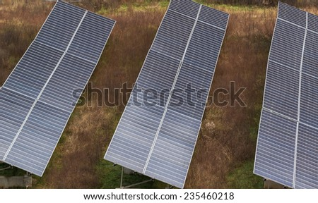 Solar panel farm producing clean green energy - stock photo