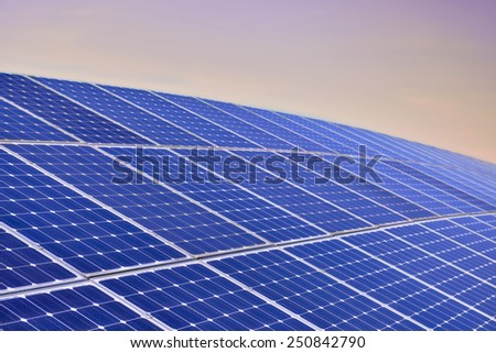 Solar Panel Field Aganinst The Sunrise - stock photo