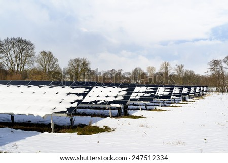 Solar Panel field in Bavaria Germany with snow on panels - stock photo