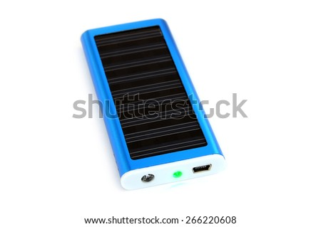 Solar panel for charging mobile phone - stock photo