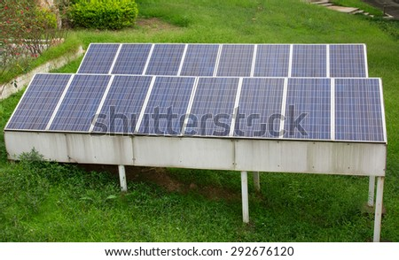 Solar panel in the green grass - stock photo