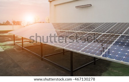 Solar Panel installation for renewable energy with sunsets light.
