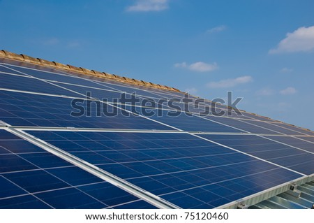 Solar panel on a house roof. Photovoltaic energy. Green energy from sun.