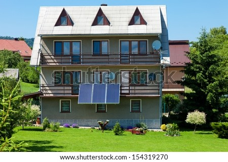 Solar panel on a residential house - stock photo