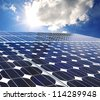 Solar panel on a sunny day blue sky - stock photo