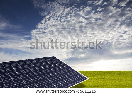 Solar Panel on the field with nice sky - stock photo