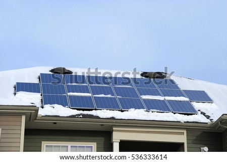 solar panel on the roof after snow in winter