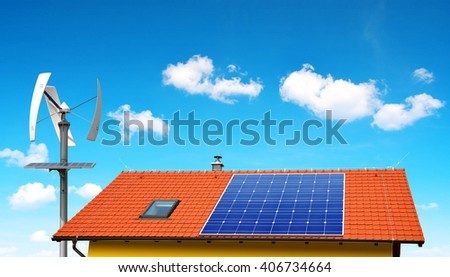 Solar panel on the roof of the house in the background wind turbine.